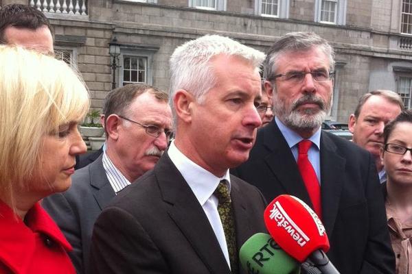 Seán Crowe speaks with the media